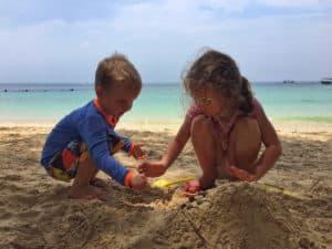 Playing on manukan island beach