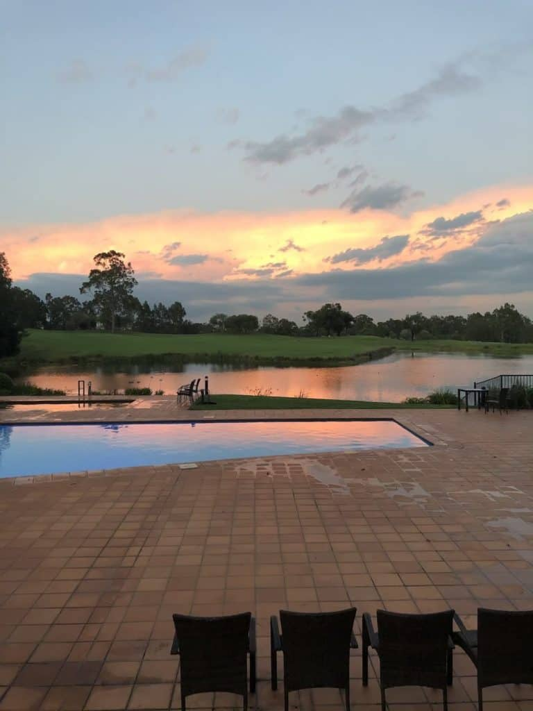 Sunset overlooking the swimming pool at Oaks Cypress Lakes Resort