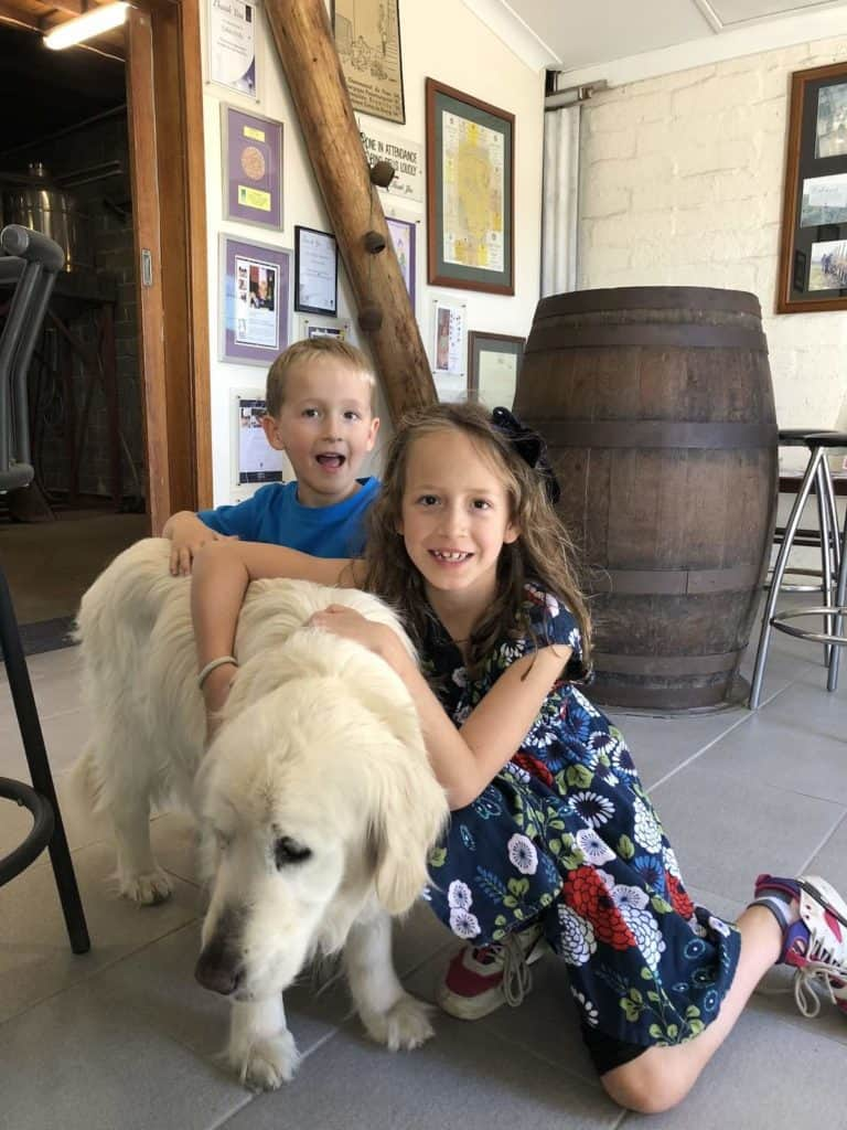 Kids with wine dog in Hunter Valley winery