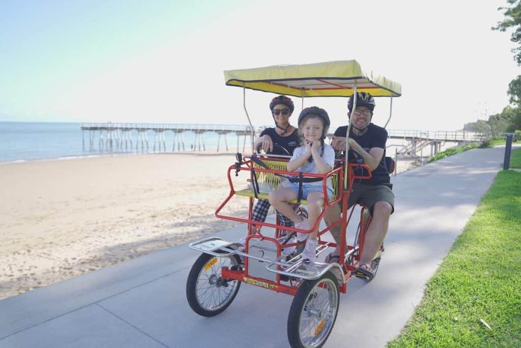 Family cycling the Hervey Bay Esplanade