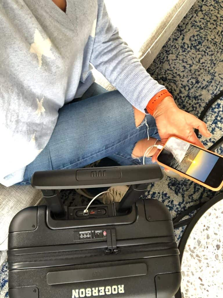 Charging iPhone with July Carry On Suitcase