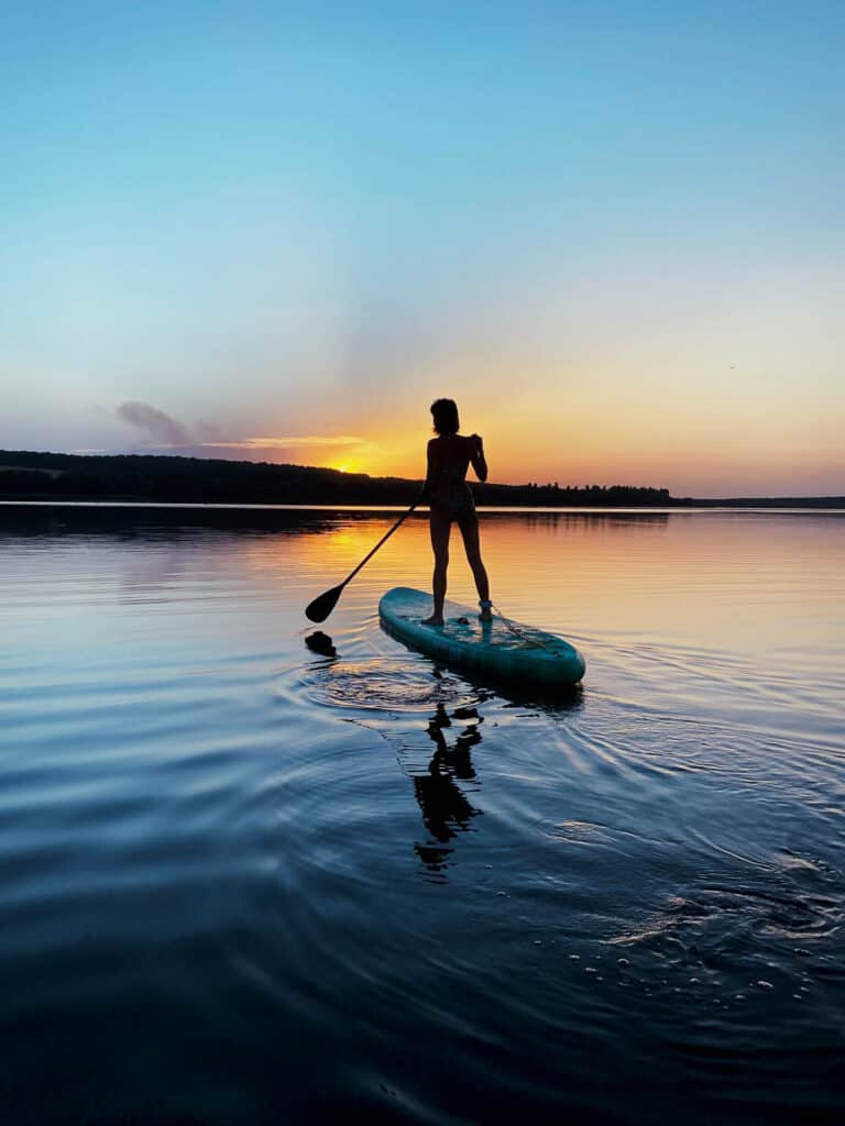 Inflatable Paddle Boarding at sunset